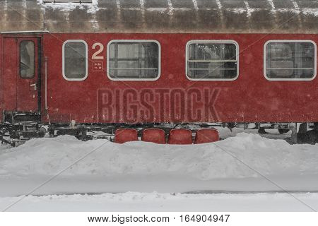 Bucharest Romania January 29 2014: A train is seen in Gara de Nord main railway station during a blizzard.
