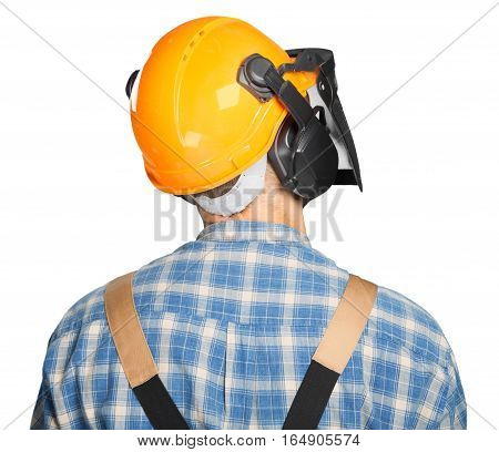 Closeup of a Man Wearing a Safety Helmet with Visor and Hearing Protection
