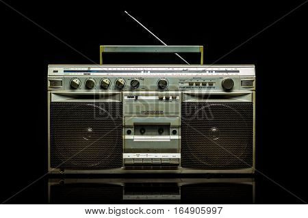 Vintage silver radio boom box on black background