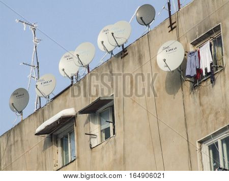 Bucharest Romania January 13 2008: Television antennas are seen on block of flats located in a periphery of Bucharest.