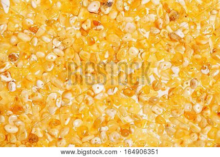 Yellow amber stones on a white background.