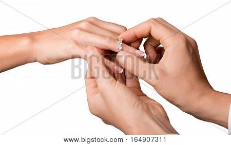 Closeup of a Man Giving an Engagement Ring to his Girlfriend