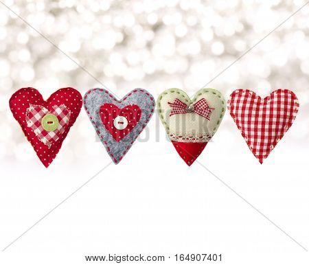 hand made textile hearts. Textile handicraft isolated on white background. Valentines Day Wedding composition with hearts. poster
