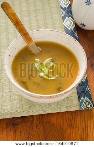 Japanese yellow awase or mixed miso soup with chopped spring onion or scallions