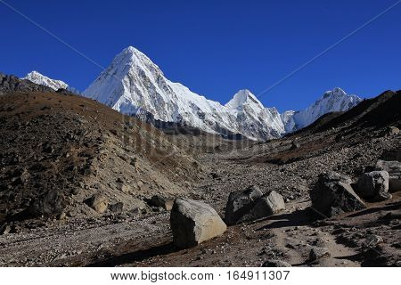 Mountain landscape in the Everest National Park Nepal. Majestic mount Pumori. Path leading towards the Everest base camp.