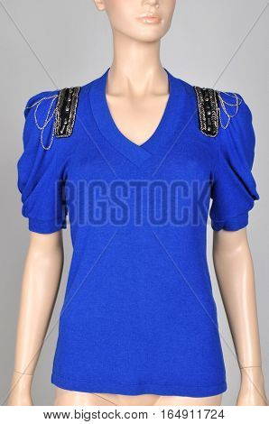 Women's blouse (tunic) in royal blue. clothes on a mannequin isolated on gray background