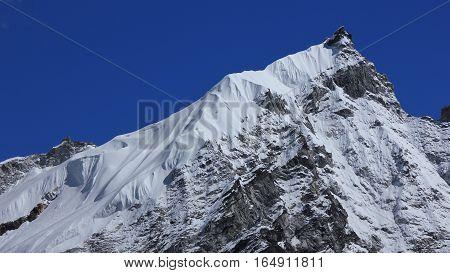 Scene in the Everest National Park Nepal. Glacier on top of mount Kongma Tse.