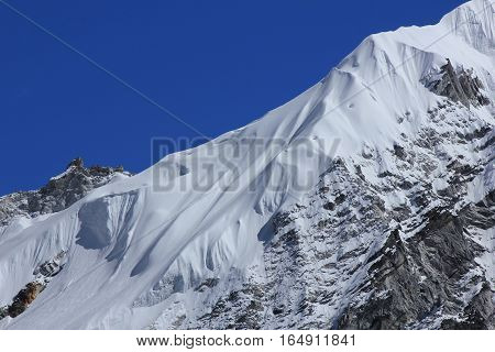 Glacier on top of a mountain in the Everest National Park. Nature background.