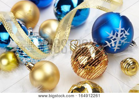 Gold And Blue Decorations On The Snow. Christmas Decorations.