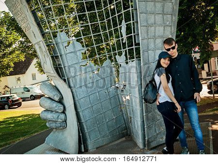 Minehead UK - July 27 2016: Couple posing in the metal sculpture that marks the start of 630 miles of the South West Coast Path in Minehead Somerset England UK