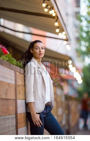 Confident woman - portrait of serious beautiful mixed race Asian Caucasian young businesswoman in casual clothes outdoor posing on city street looking at camera