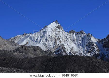 Snow capped mountain Kongma Tse Everest National Park Nepal. Nature background.