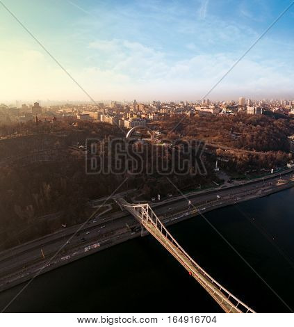 Aerial view of Kiev, Ukraine in winter. Khreshchatyi park and the Arch of Friendship of Peoples from the left side and the river Dnepr with the right hand.