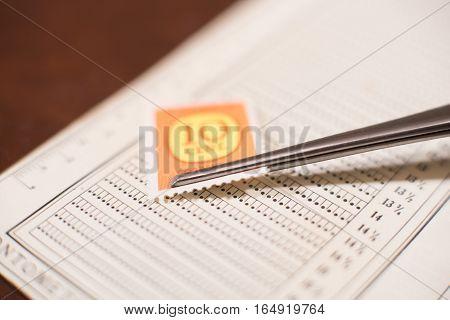 Measuring Perforation Of Old Postal Stamp