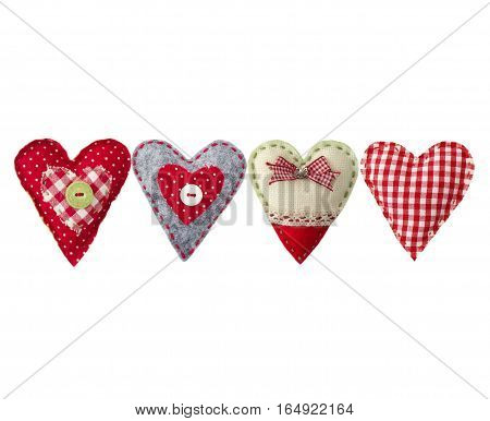hand made textile hearts. Textile handicraft isolated on white background. Valentines Day Wedding composition with hearts.
