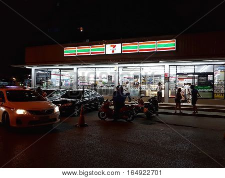 BANGKOK THAILAND - NOVEMBER 29: Illuminated Seven Eleven convenient store in the night on November 29 2016 in Bangkok Thailand.