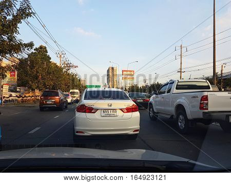 BANGKOK THAILAND - NOVEMBER 29: Daily traffic jam in the afternoon shot through the windshield of a car on November 29 2016 in Bangkok Thailand.