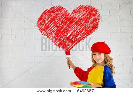 Child painting big red heart on the wall. Valentines day card. Home renovation and design concept