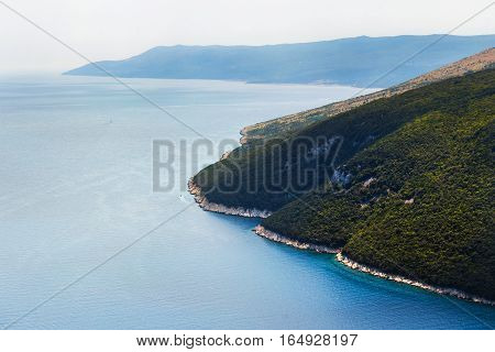 top view of the sea strait or bay without boats and people. Quiet, calm. Croatia, Plomin.