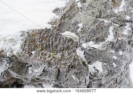 Detailed photo of ice and snow on the rock