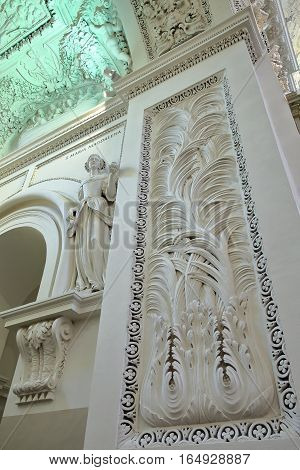 VILNIUS, LITHUANIA - DECEMBER 31, 2016: The interior of St Peter and St Paul's Church with over 2000 stucco mouldings representing miscellaneous religious and mythological scenes