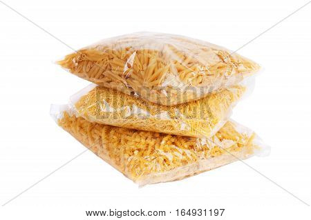 Three packages of macaroni on a white background
