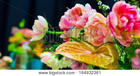 Flower wedding holiday decoration, beautiful pink roses peony and lily blooming bouquet on black panorama