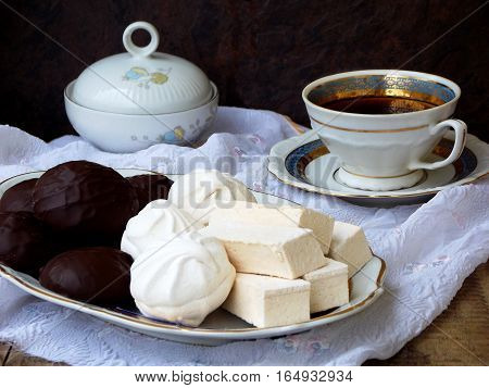 Sweet White Russian Marshmallow, Chocolate Zephyr, Meringue, Apple Pastila And Cup Of Coffee On Wood