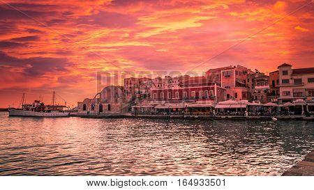 Stunning sunset view of the old venetian port of Chania on Crete island Greece.