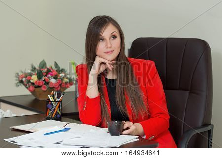 Picture Of Pensive Businesswoman With Documents And Coffee In Red Suit Sitting At The Table With Doc