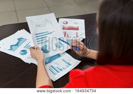 Businesswoman Reading Documents At Office Desk. Close Up Business Team Analysis And Strategy Concept