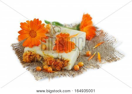 Natural handmade soap with calendula and sea-buckthorn isolated on white