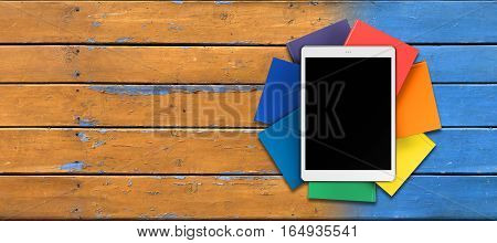 tablet on pile of book in the form of a flower, on a background of old boards mockup front view, 3d illustration