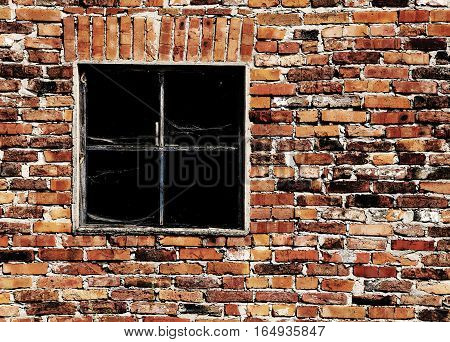 old brick wall with a broken square window