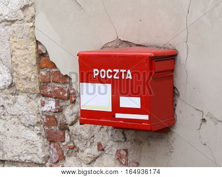 old red mailbox with the words POLISH POSTAL service