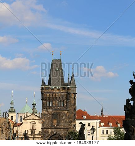 High Tower With Battlements Of The Charles Bridge In Prague Old