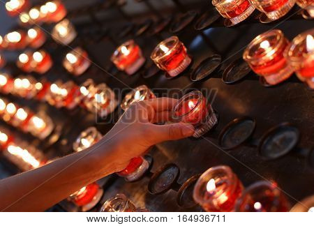 Red Candles Lighted And The Hand Of The Child