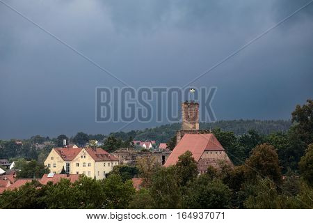 Hilpoltstein With Castle Ruin Under Stormy Sky