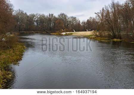 Landscape at gloomy autumnal day a on a Psel river Ukraine