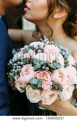 Wonderful bridal bouquet with flowers of white and pink flowers
