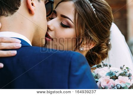Light makeup of the bride in the wedding day