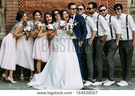 Young Couple With The Funny Friends On The Wedding