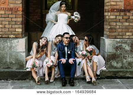 Angry bride and groom with the bridesmaids