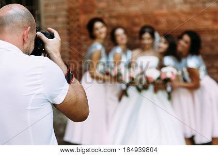 Cameraman Is Taking A Picture Of The Bridesmaids And A Bride