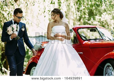Bride In The Dress And A Groom With A Bouquet