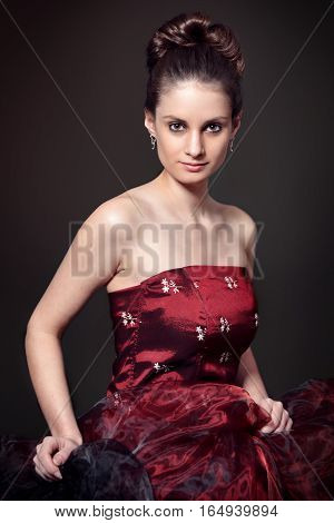 portrait of young women in red corset