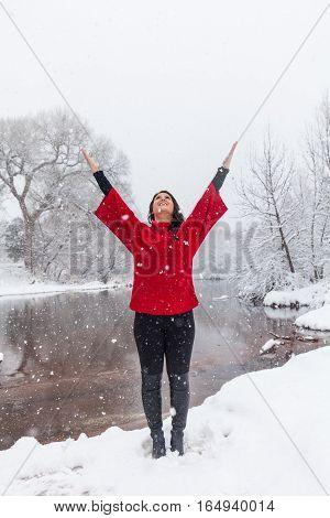 an attractive woman praising a rare winter snow near Sedona Arizona