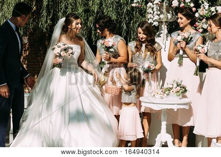Bride and bridesmaids on the wedding ceremony