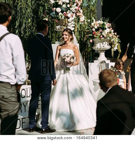 Flowers And A Happy Bride On The Wedding Ceremony