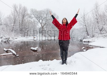 an attractive woman praising a rare winter snow near Sedona Arizona